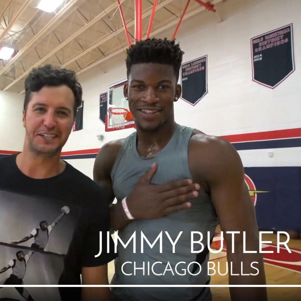 Bulls guard Jimmy Butler plays basketball against Luke Bryan in Florida