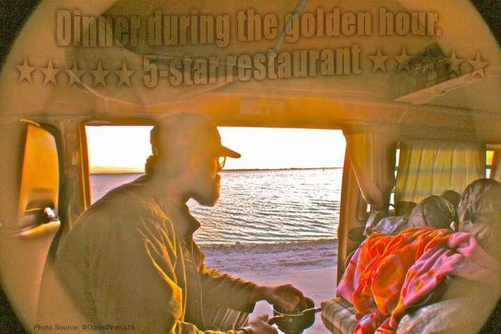 Daniel Norris enjoys dinner in his VW Van overlooking the ocean.