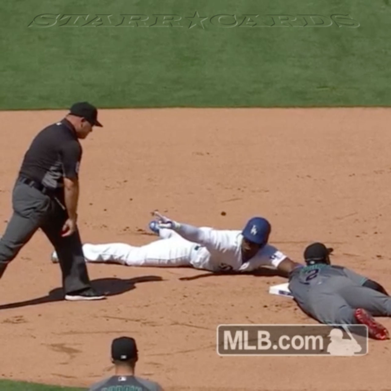 Dodgers' Yasiel Puig is safe at second after avoiding tag