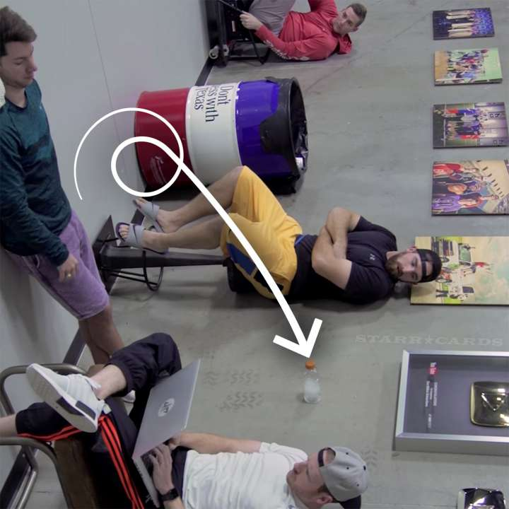 Dude Perfect's water bottle flip trick optical illusion shown right side up