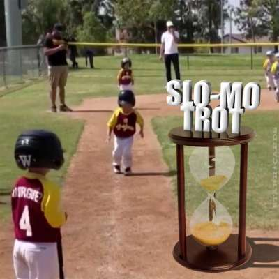 Kid makes slow-motion run to home plate after home run