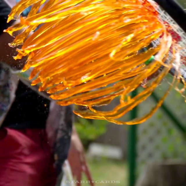 Orange Jell-O sliced up by a tennis racket