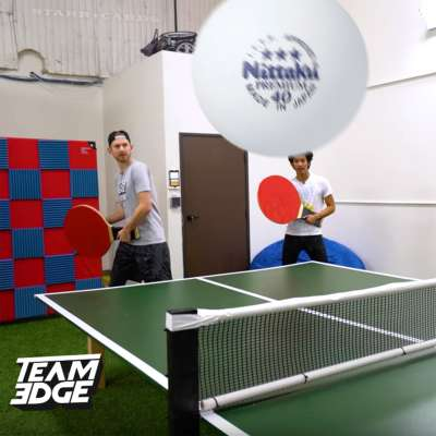 Team Edge's J-Fred and Marlin Ramsey Chan form a doubles team in giant table tennis