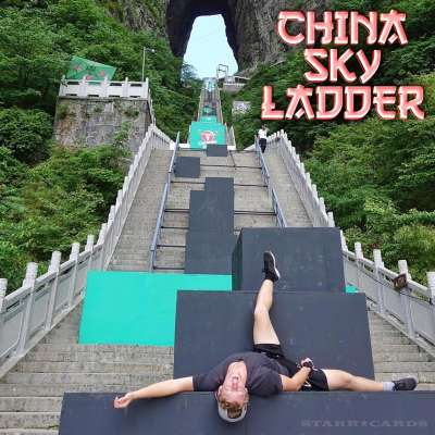 Alex Schauer rests after descending Sky-Ladder Challenge parkour course at Tianmen Mountain